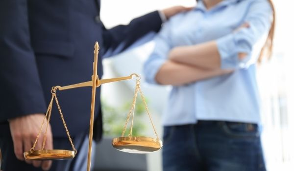 personal injury attorney with client